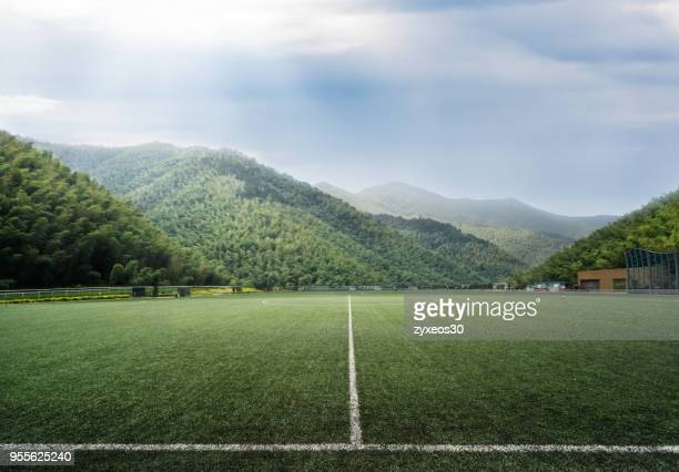 soccer stadium in the natural environment.china - east asia, - voetbalveld stockfoto's en -beelden
