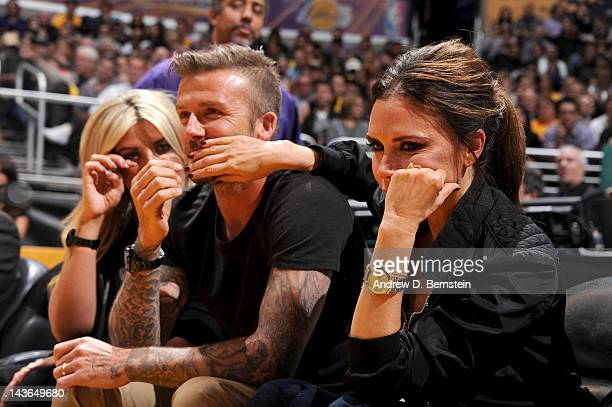 Soccer star David Beckham and his wife Victoria attend a game between the Denver Nuggets and the Los Angeles Lakers in Game Two of the Western...