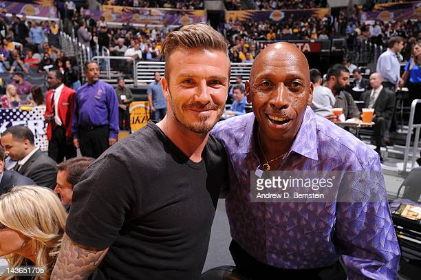 Soccer star David Beckham poses for a photograph with Recording artist Jeffrey Osborne during halftime of a game between the Denver Nuggets and the...