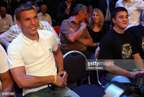 Soccer star Lukas Podolski looks on during the fight between Felix Sturm of Germany and Randy Griffin of United States of America at the Gerry Weber...