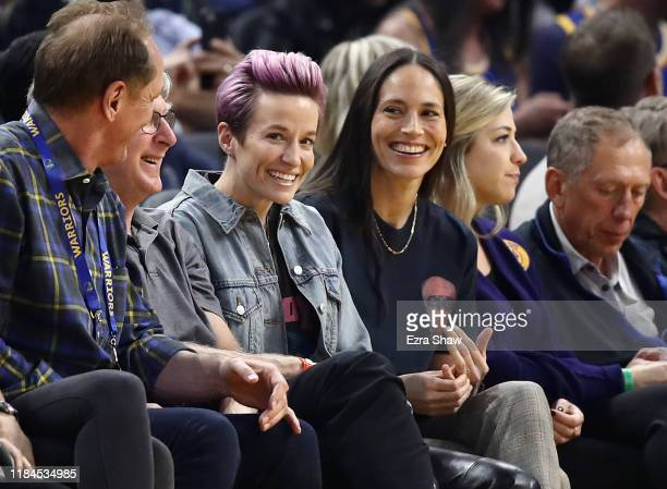 Soccer star Megan Rapinoe and WNBA star Sue Bird watch the Golden State Warriors play against the Phoenix Suns at Chase Center on October 30, 2019 in...