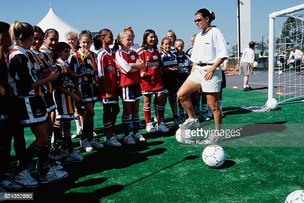 Soccer star Mia Hamm speaks with a group of girls at a soccer training clinic in Los Angeles California