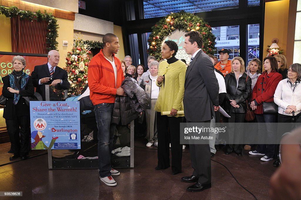 AMERICA - Soccer star Oguchi Onyewu stops by Times Square to donate to the 'Warm Coats & Warm Hearts' holiday coat drive, on GOOD MORNING AMERICA, 12/1/09 airing on the ABC Television Network. GM09 (Photo by Ida Mae Astute/ABC via Getty Images) OGUCHI