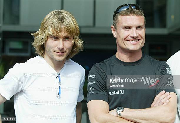 Soccer star Pavel Nedved of Juventus with David Coulthard of Scotland and McLaren prior to the Formula One Monaco Grand Prix on May 31 2003 in Monte...