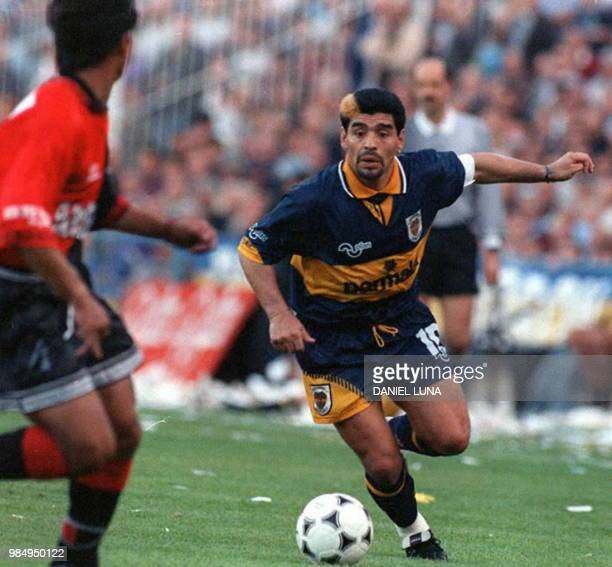 Soccer superstar Diego Maradona of the Boca Juniors of Buenos Aires goes after the ball as an unidentified member of the soccer team Colon de Santa...