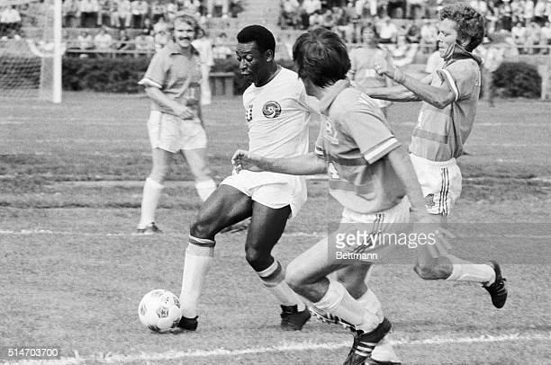 Soccer superstar Pele runs with the ball during his first game for the New York Cosmos against the Dallas Tornadoes.
