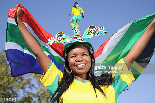 Soccer supporter waving flag, Johannesburg, South Africa