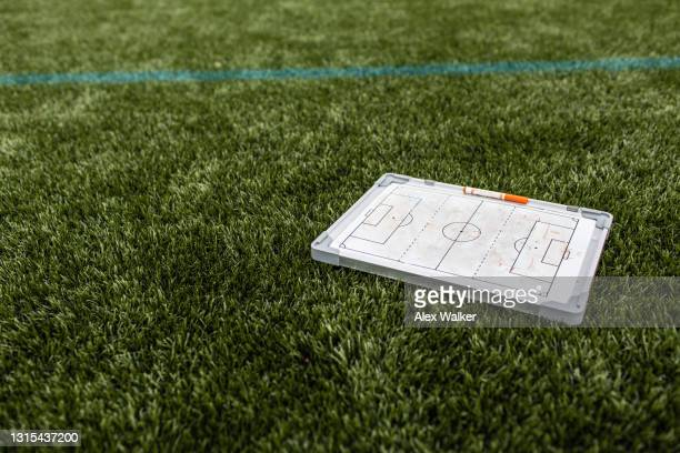 soccer tactics board on astroturf grass - sports league stock pictures, royalty-free photos & images