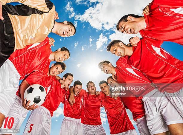 Soccer team against blue sky.
