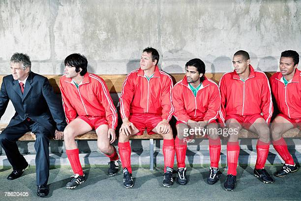 soccer team and coach on bench - football team stock pictures, royalty-free photos & images
