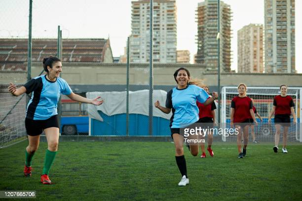 soccer team celebrates scoring a goal in a competition. - soccer competition stock pictures, royalty-free photos & images