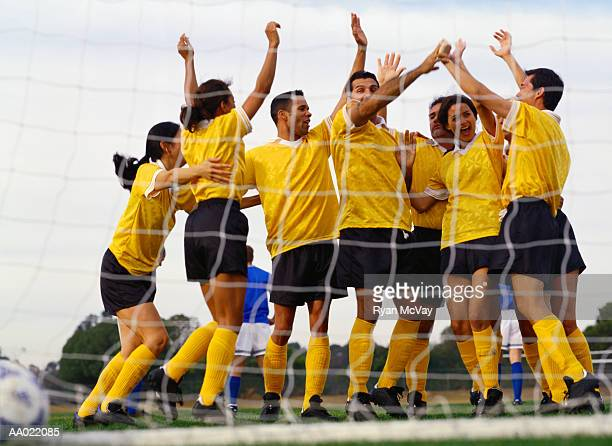 soccer team celebrating in front of goal - amateur stock pictures, royalty-free photos & images