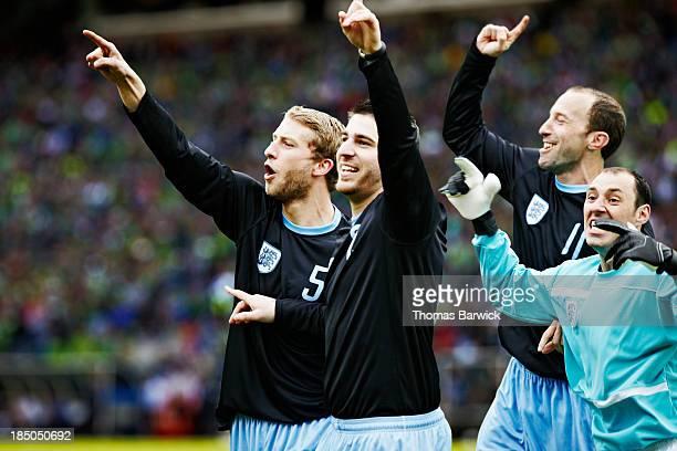 Soccer team celebrating together in stadium