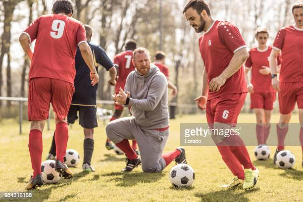 a soccer team during an intense soccer football training session with the coaching team - coach stock pictures, royalty-free photos & images