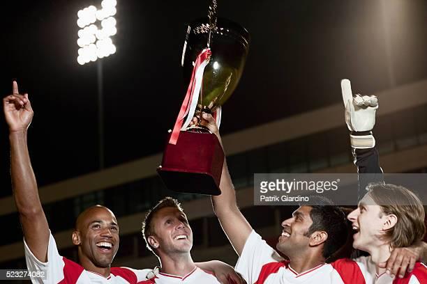 Soccer team holding up trophy