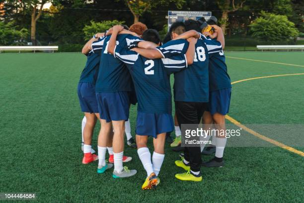 soccer team huddling before a game - pep talk stock pictures, royalty-free photos & images