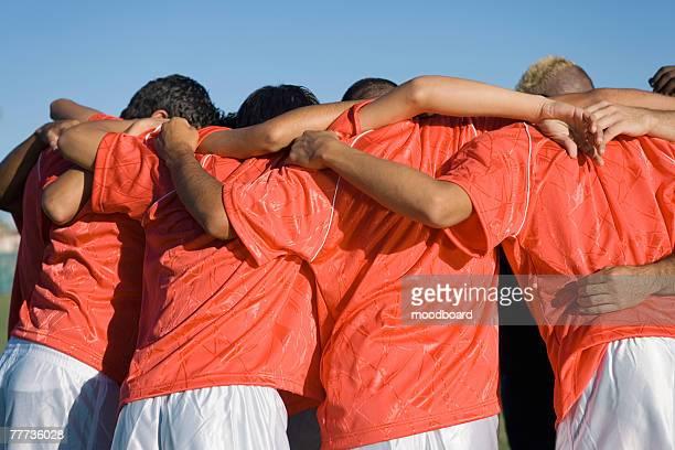 Soccer Team in Huddle