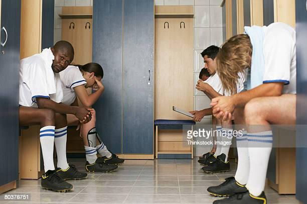 soccer team in locker room - niederlage stock-fotos und bilder
