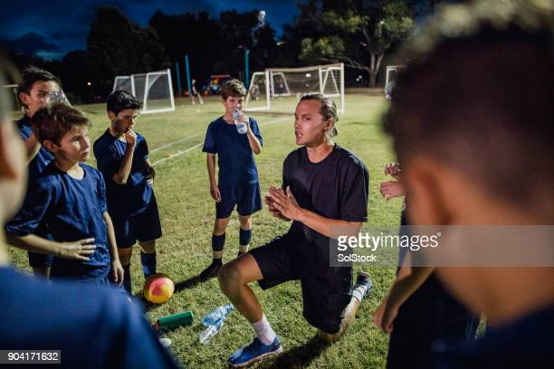 soccer team meeting - coach stock pictures, royalty-free photos & images