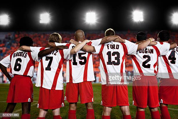 soccer team on field - football team stock pictures, royalty-free photos & images