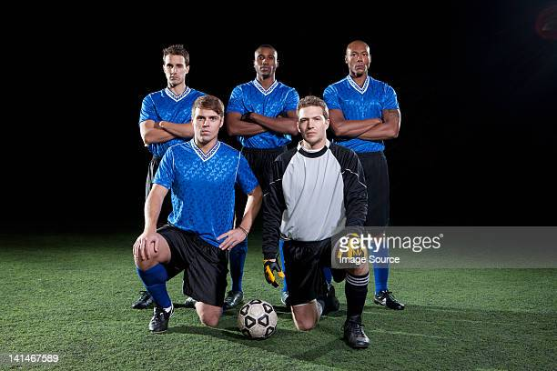 soccer team on pitch at night - soccer team stock pictures, royalty-free photos & images