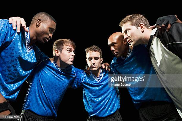 soccer team planning game in huddle - huddling stock pictures, royalty-free photos & images