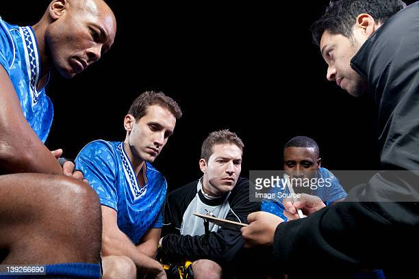 soccer team planning game with coach - coach stock pictures, royalty-free photos & images