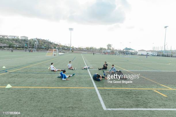 soccer team stretching on field - track and field stadium stock pictures, royalty-free photos & images
