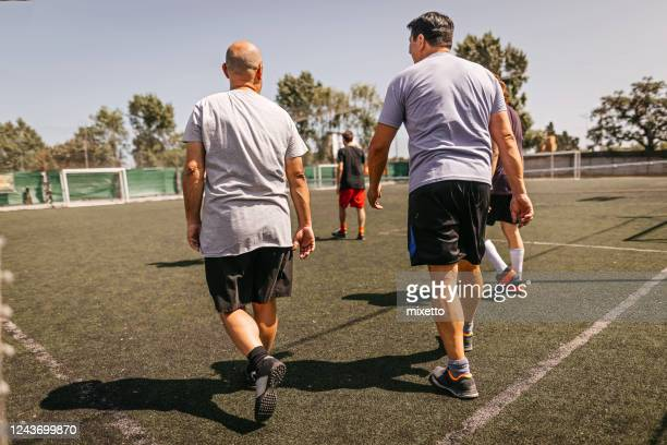 soccer team walking on field - soccer competition stock pictures, royalty-free photos & images