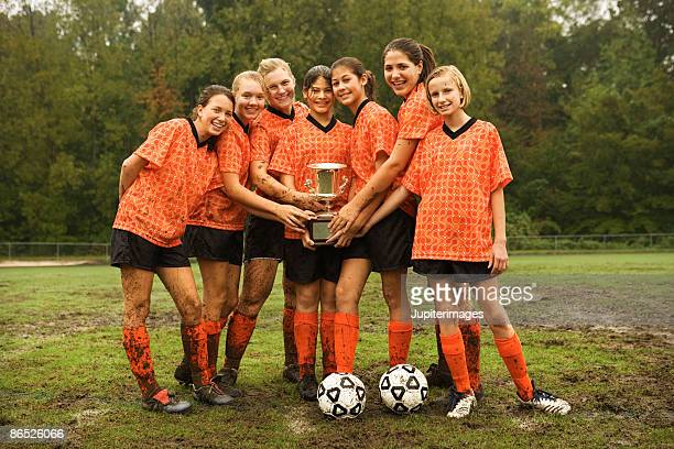 soccer team with trophy - soccer team stock pictures, royalty-free photos & images
