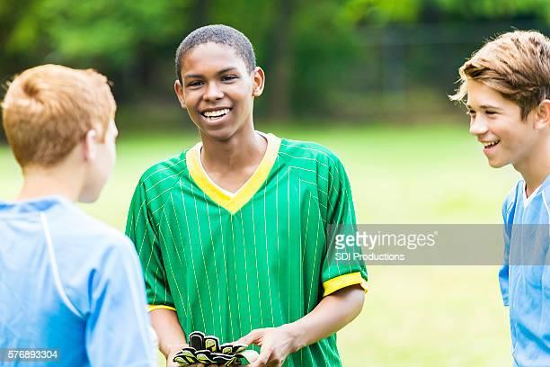 Soccer teammates talks with opposing team