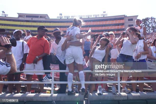 SIMON US soccer team's BRANDI CHASTAIN HUGS HER HUSBAND Santa Clara SOCCER COACH JERRY SMITH AFTER SHE SCORED IN SHOOT OUT TO SEAL US VICTORY IN...