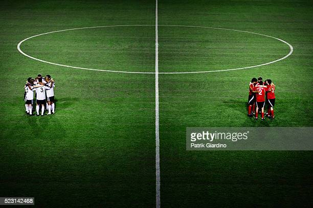 soccer teams huddling - football team stock pictures, royalty-free photos & images