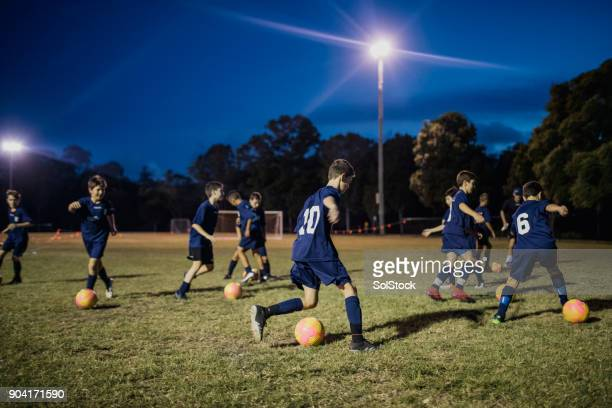 soccer training drill - sports training camp stock pictures, royalty-free photos & images