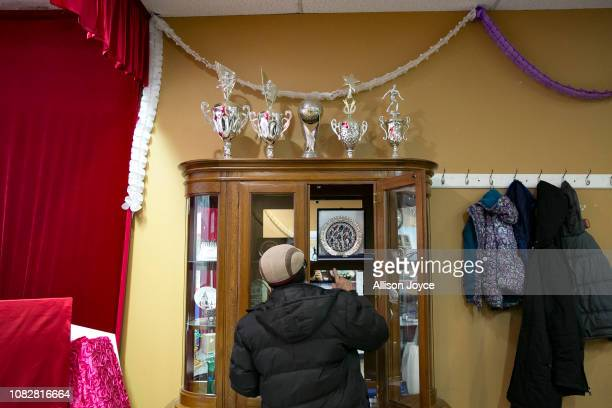Soccer trophies are seen on top of a display case at the Rohingya Cultural Center of Chicago on January 10 2019 in Chicago Illinois Chicago has one...