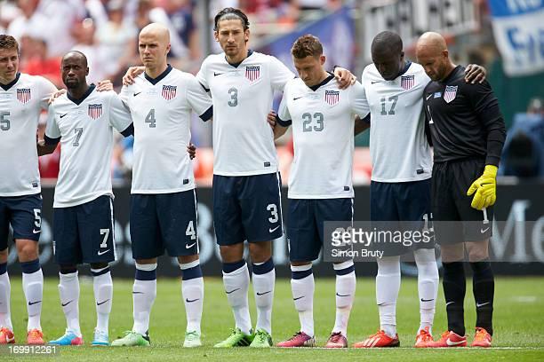 USA Matt Besler DaMarcus Beasley Michael Bradley Omar Gonzalez Fabian Johnson Jozy Altidore and goalie Tim Howard lined up on field before...