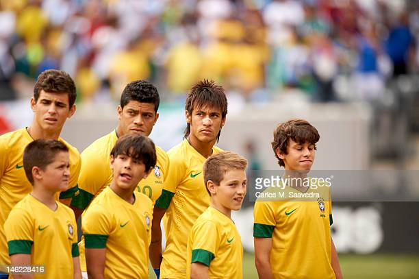 View of Brazil Neymar and teammates on field with children before International Friendly vs Argentina at MetLife Stadium. East Rutherford, NJ...