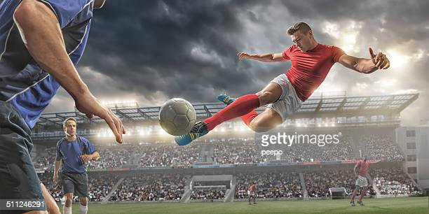 soccer volley kick - football player stock pictures, royalty-free photos & images