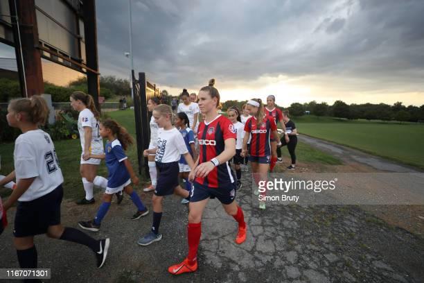 Washington Spirit Elise KellondKnight leading team into stadium holding hands with girls vs Utah Royals at Maureen Hendricks Field at Maryland...