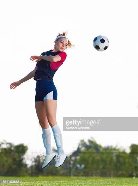 Soccer Women heading the Ball