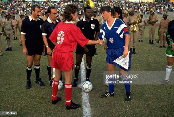Soccer Women's National Team USA April Heinrichs shaking hands with Donnelly before game PortauPrince HTI 4/28/1991