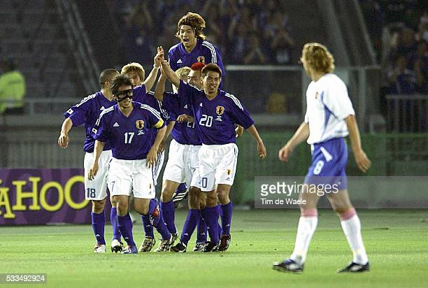 Japan Russia Japanese players celebrate scoring a goal