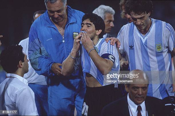 Soccer World Cup ARG Diego Maradona victorious kissing jersey after winning semifinal game on penalty kicks vs ITA Naples ITA 7/3/1990