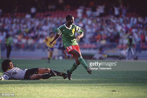 Soccer World Cup Cameroon Roger Milla in action scoring goal vs Colombia goalie Rene Higuita Naples Italy 6/23/1990