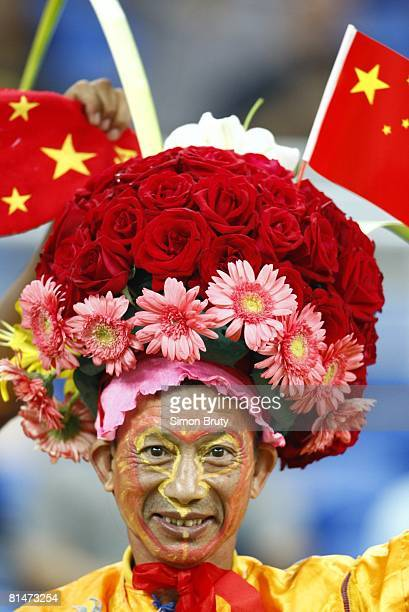 Soccer World Cup Closeup of China fan wearing unusual hat in stands during game vs New Zealand Tianjin China 9/20/2007