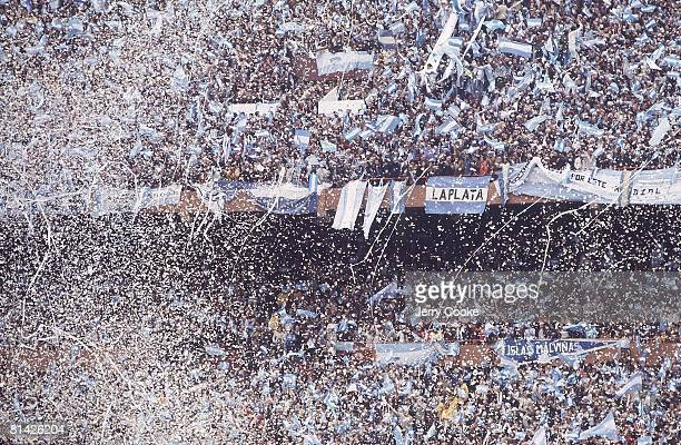 Soccer World Cup Final Argentina fans victorious in stands after winning game vs Netherlands Confetti Buenos Aires Argentina 6/25/1978