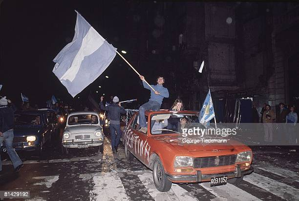 Soccer World Cup Final Argentina fans victorious in street with flag after winning game vs Netherlands Buenos Aires Argentina 6/25/1978