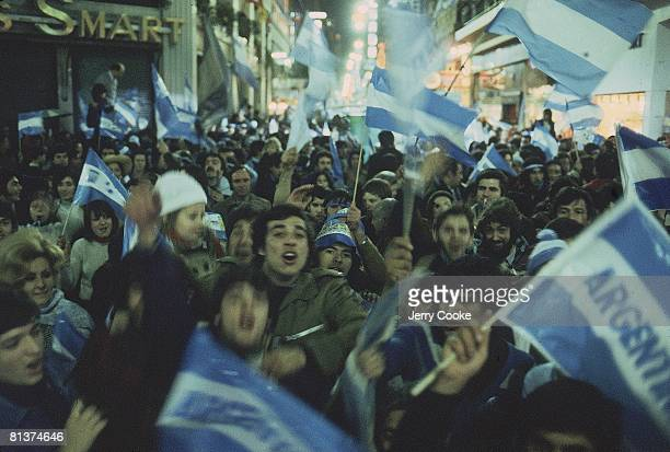 Soccer World Cup Final Argentina fans victorious in street with flags after winning game vs Netherlands Buenos Aires Argentina 6/25/1978