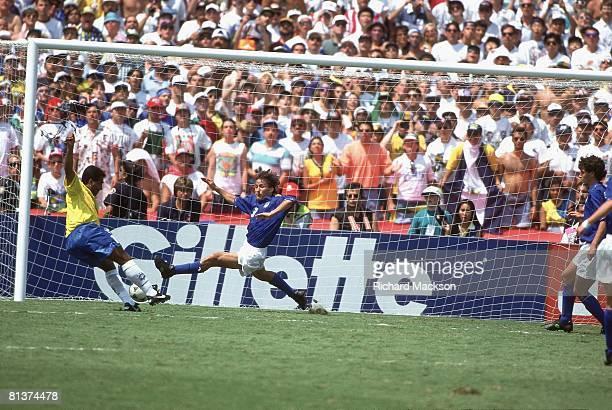 Soccer World Cup final BRA Romario in action missing shot vs ITA Antonio Benarrivo Pasadena CA 7/17/1994