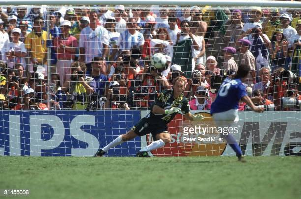 Soccer World Cup Final Brazil goalie Claudio Taffarel in action vs Italy Roberto Baggio Baggio missed penalty kick resulting in loss Pasadena CA...
